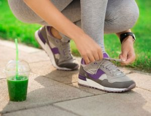 Weght Loss for diabetic putting on running shoes