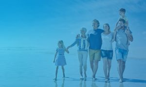 family at beach with blue overlay
