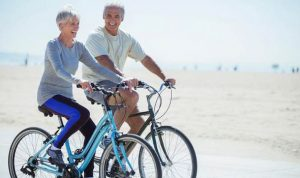 happy older couple on bikes