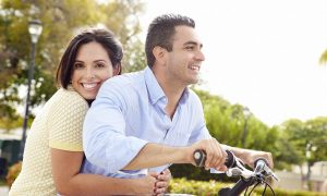 Couple on bike with Fresh Start Program