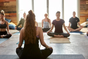 people learning meditation and yoga