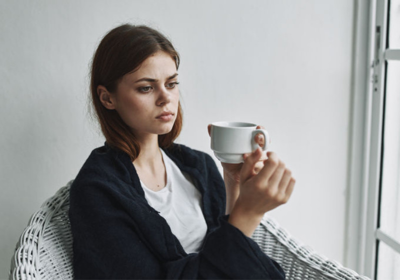 woman with tea cup thinking