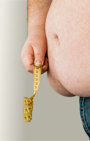 overweight man stomach measuring waist 470h